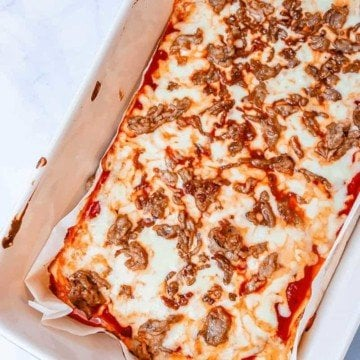 This almost no carb pizza is perfect for diet plans such as Atkins, low carb or ketogenic diets & anyone looking to reduce their carb intake.