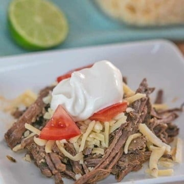 This easy low carb slow cooker shredded beef is a delicious chili lime barbacoa that you can enjoy in a bowl with your favorite toppings or on a tortilla!