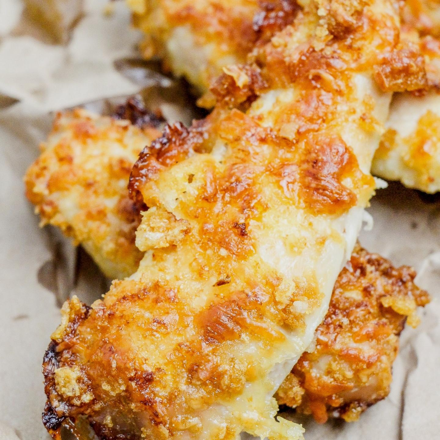 baked chicken tenders on parchment paper