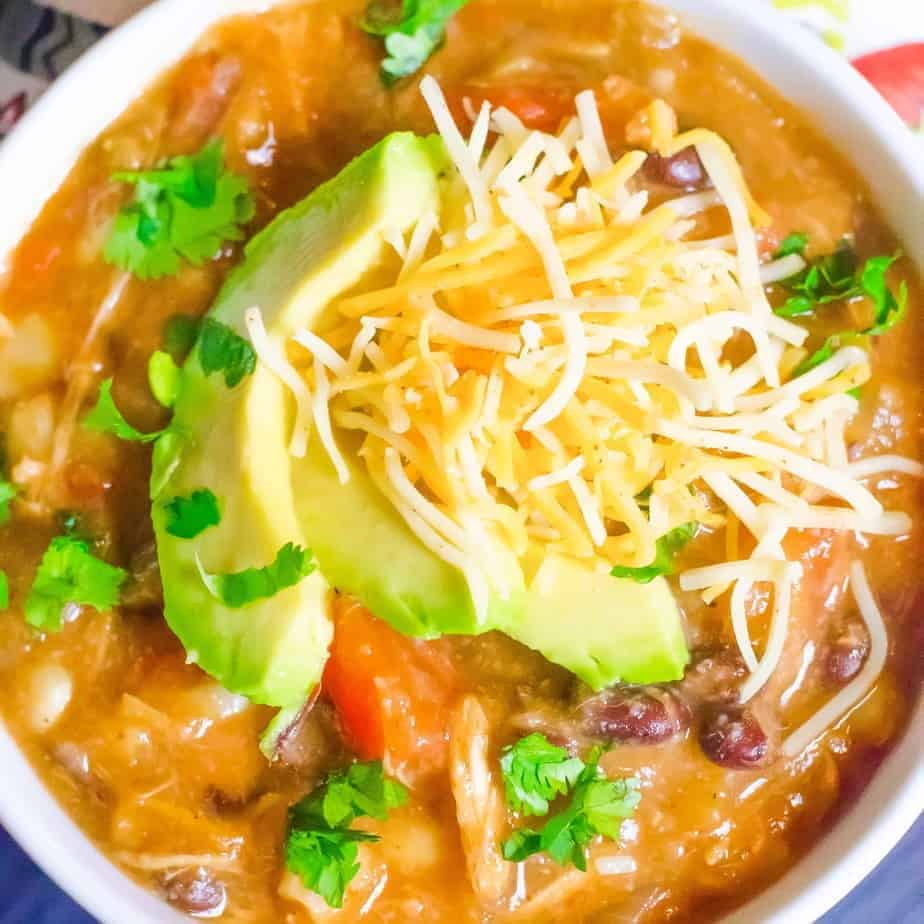 top view of enchilada soup in a white bowl