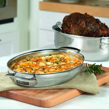 Viking Oval Roasting pan with Bottom Round Roast, Induction Lid with Scalp Potatoes resting on wood cutting board.